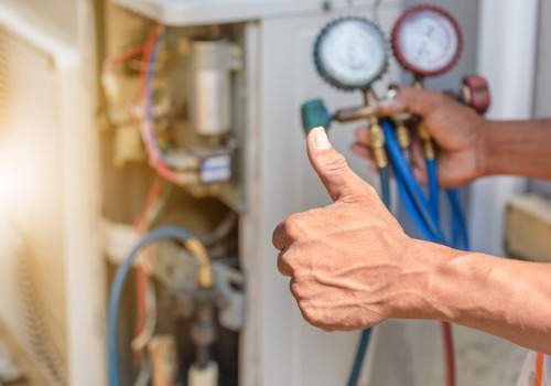 Technician giving a thumbs up after repairing an HVAC system
