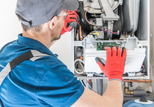 A technician performing repairs on Furnaces in St. Louis MO