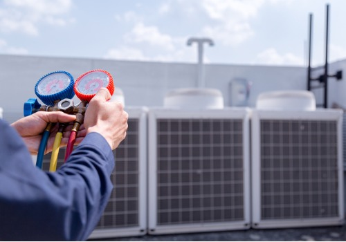 A technician performing Air Conditioning Services in St. Louis MO