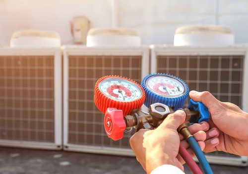 Technician Testing Air Conditioning in St. Peters MO