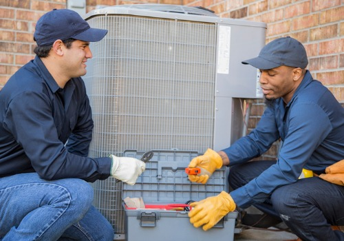 Technicians working on Air Conditioning in St. Louis MO